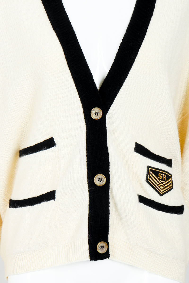 Vintage Sonia Rykiel Cream Knit Letterman Cardigan on Mannequin button placket at Recess