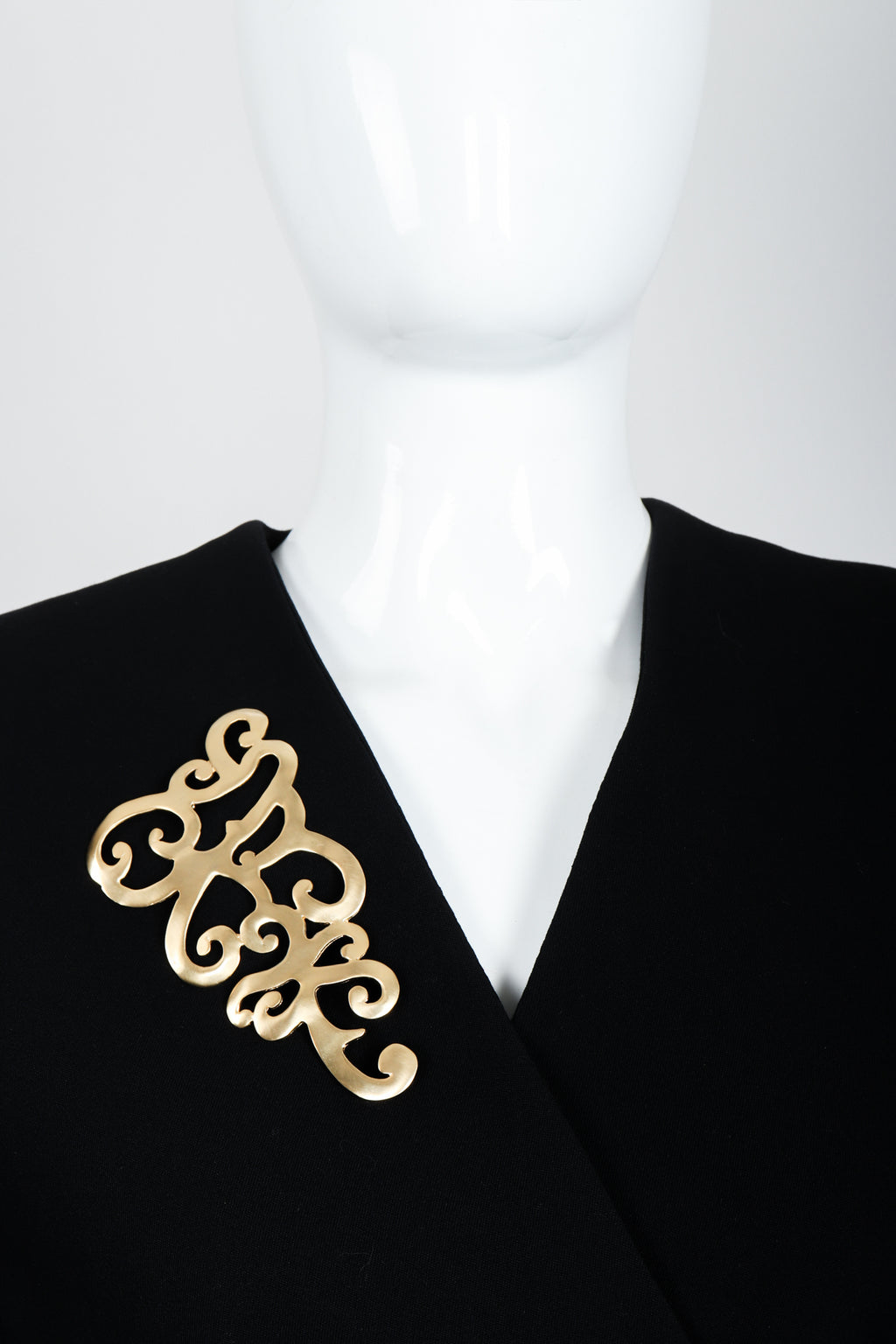 Vintage Ugo Correani Baroque Matte Swirl Brooch on mannequin at Recess Los Angeles
