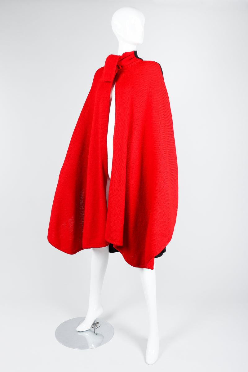 Recess Vintage Valentino Red And Black Sweater Knit Cape on Mannequin, arms at sides