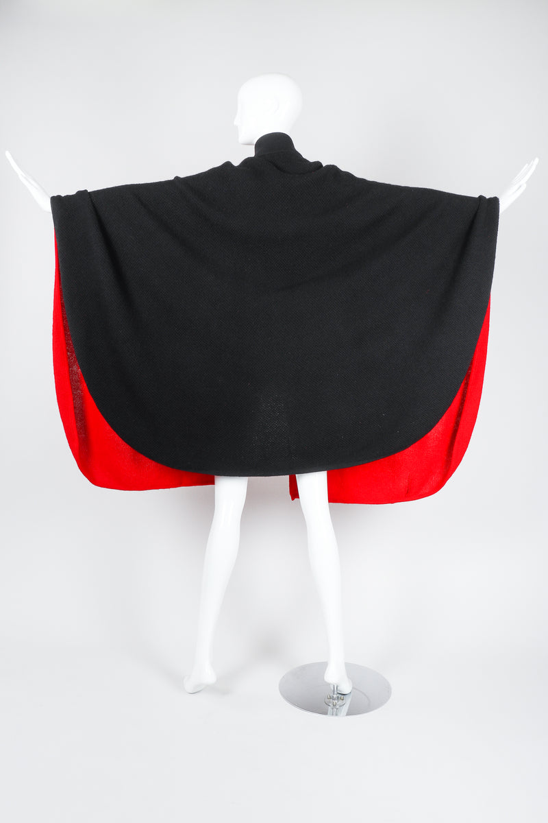 Recess Vintage Valentino Red And Black Sweater Knit Cape on Mannequin, back with arms extended