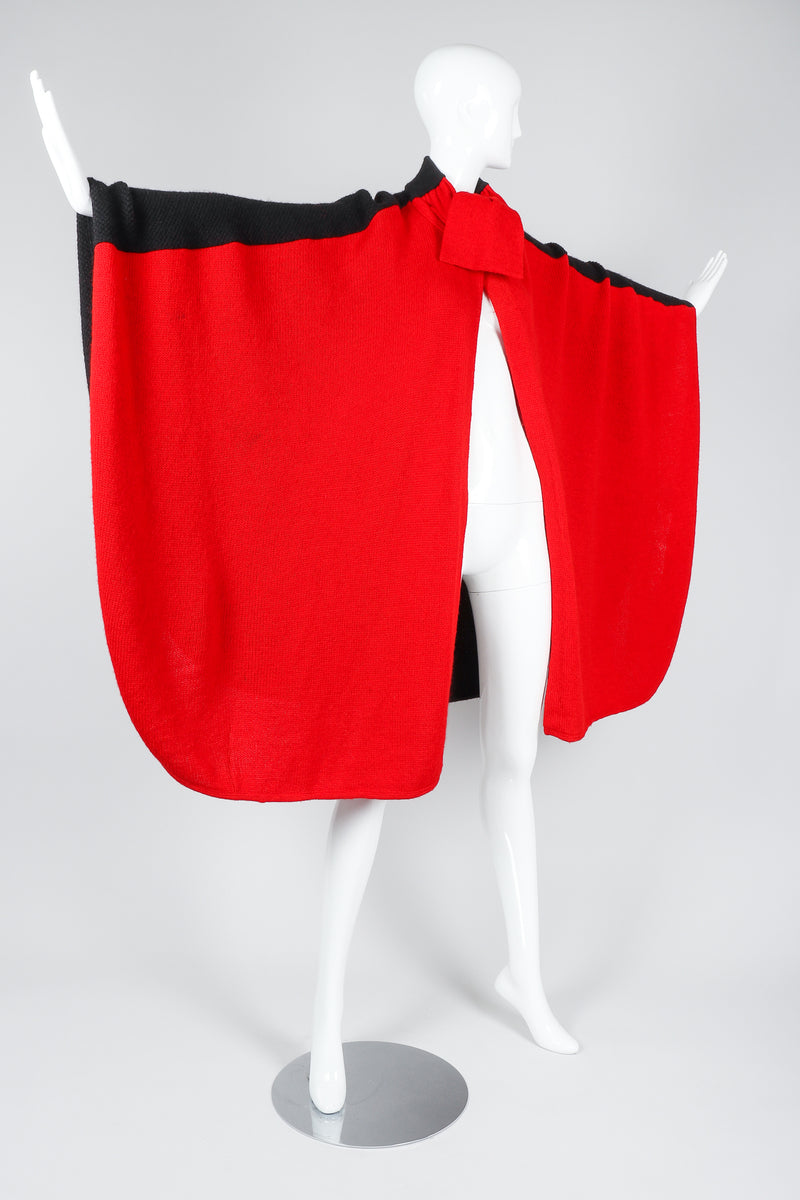 Recess Vintage Valentino Red And Black Sweater Knit Cape on Mannequin, arms extended