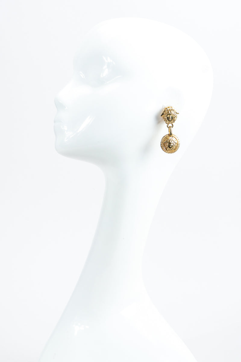 Vintage Gianni Versace Gold Medusa Head Drop Earrings on mannequin at Recess Los Angeles