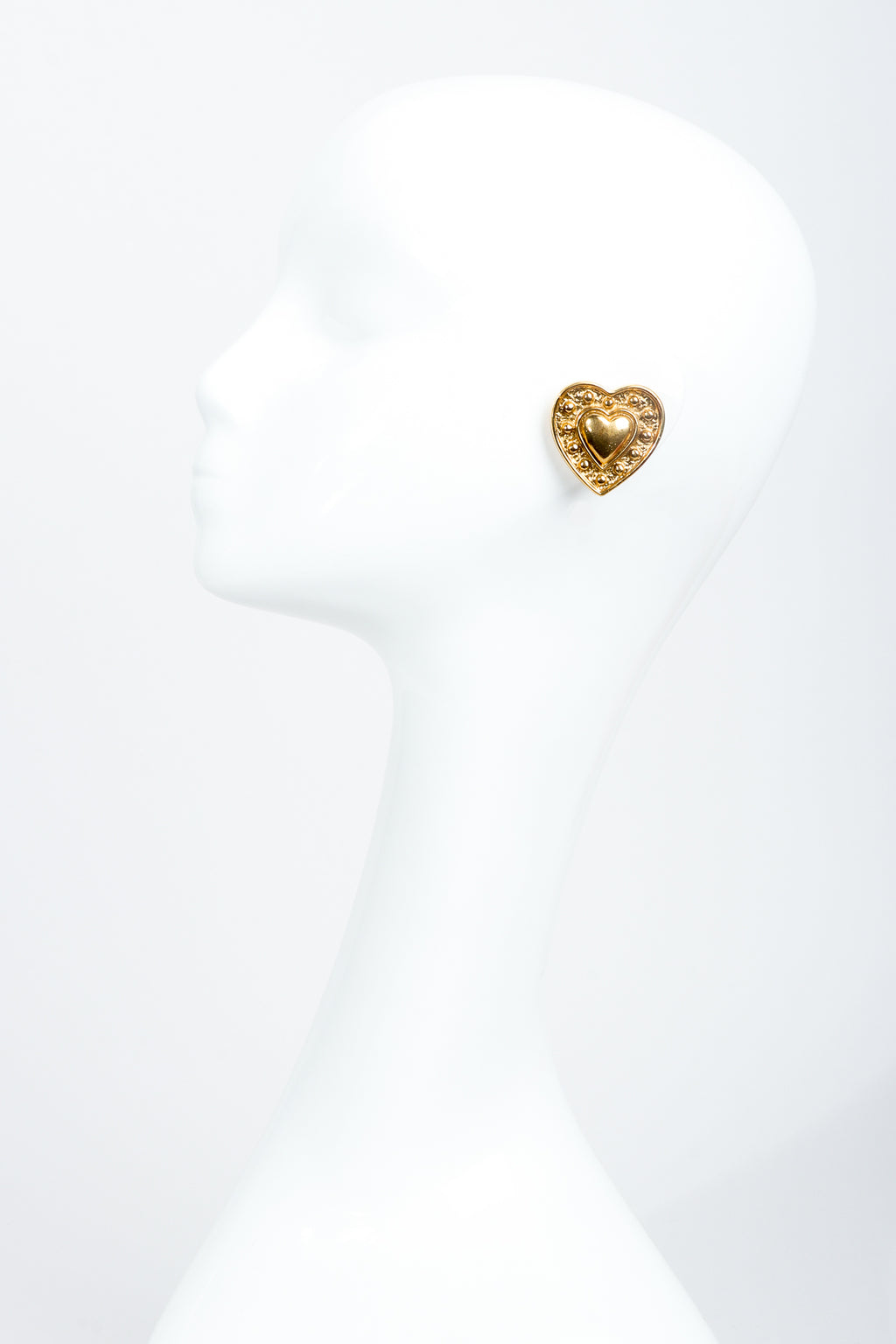 Vintage Yves Saint Laurent Gold Heart Button Clip Earrings on Mannequin at Recess Los Angeles