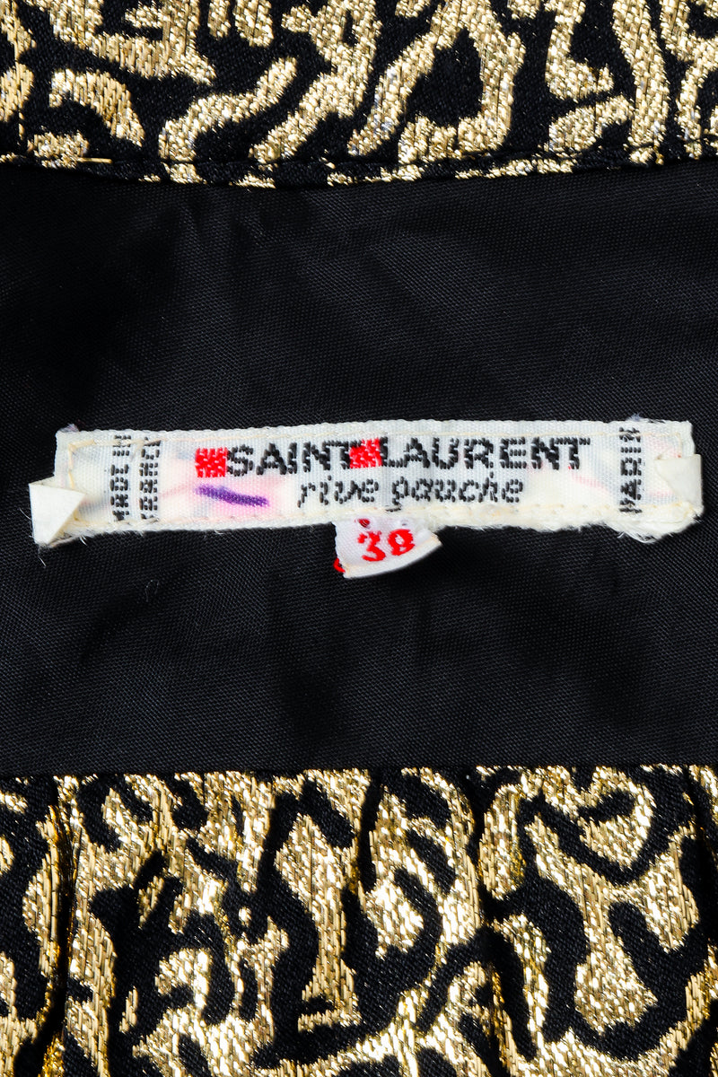 Vintage Yves Saint Laurent YSL Label on black fabric