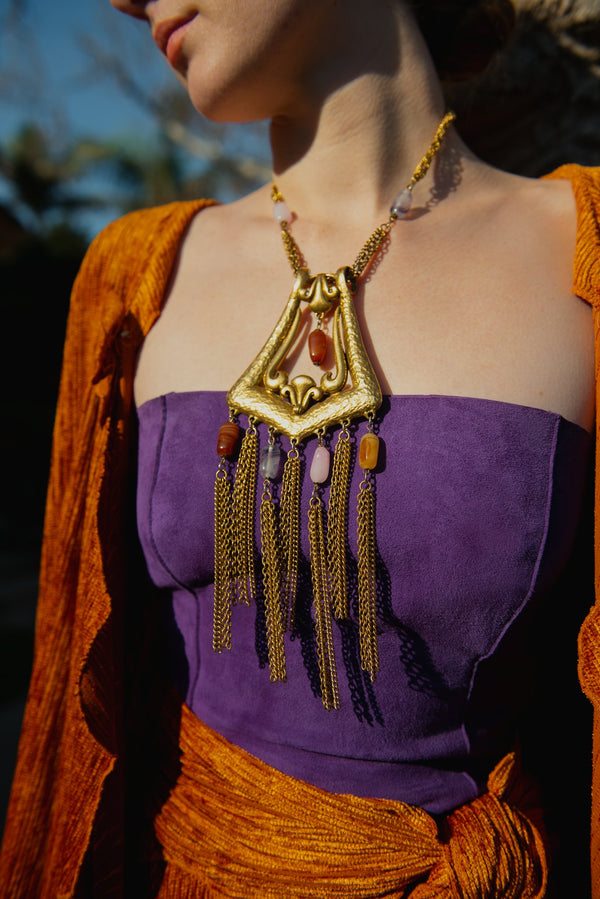 Vintage Unsigned Hammered Fringe Plate Necklace from Recess on model with purple shirt