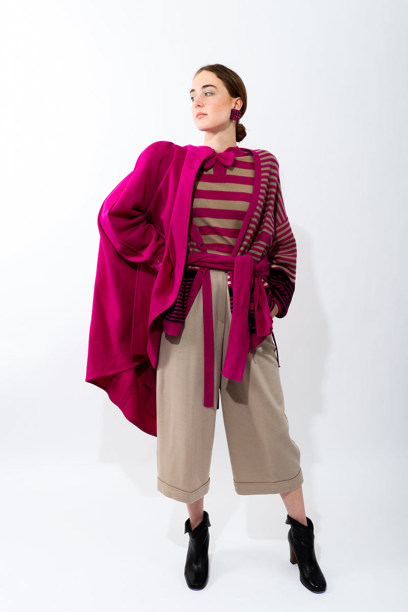 Girl wearing Vintage Sonia Rykiel Fuchsia Stripe Bow Sweater with fuchsia coat and tan pant