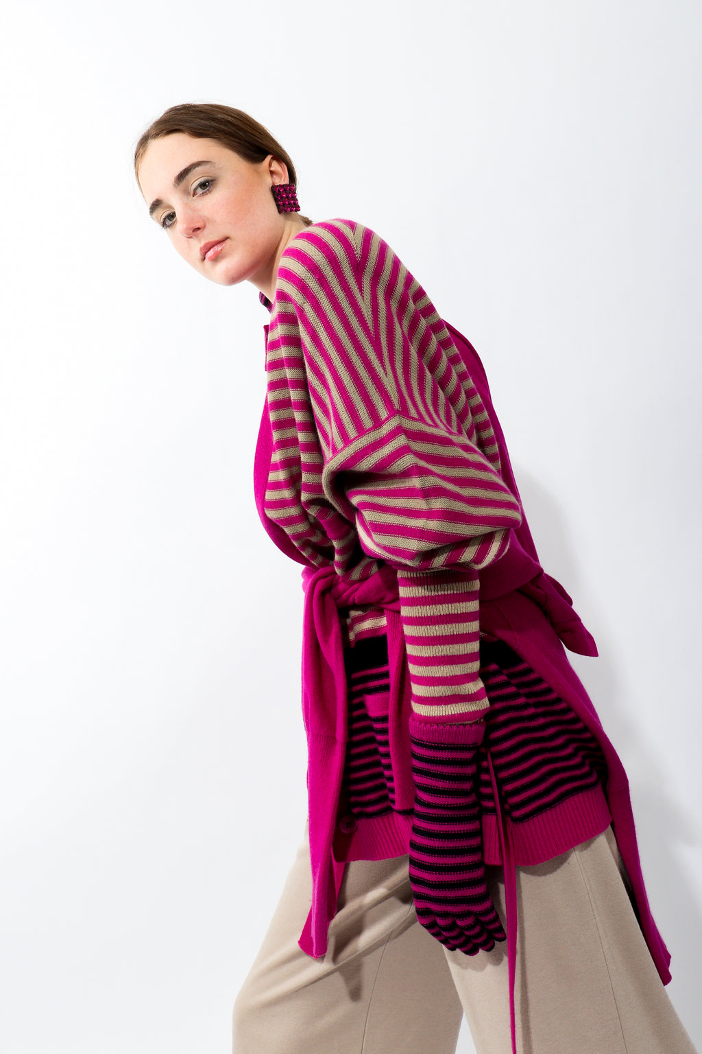 Girl wearing Vintage Sonia Rykiel Fuchsia Stripe Boyfriend Cardigan, gloves, and tan pants