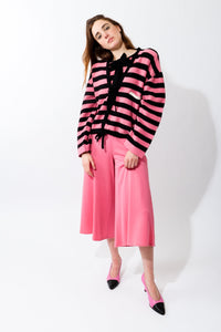 Girl in Vintage Sonia Rykiel Pink Stripe Knit Boxy Cardigan and pink pants