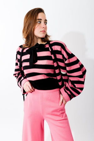 Girl in Vintage Sonia Rykiel Pink Stripe Knit Keyhole sweater and pink pants