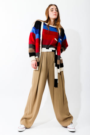 Girl wearing Vintage Sonia Rykiel Ombré Striped Knit Cardigan and sweater with taupe pant