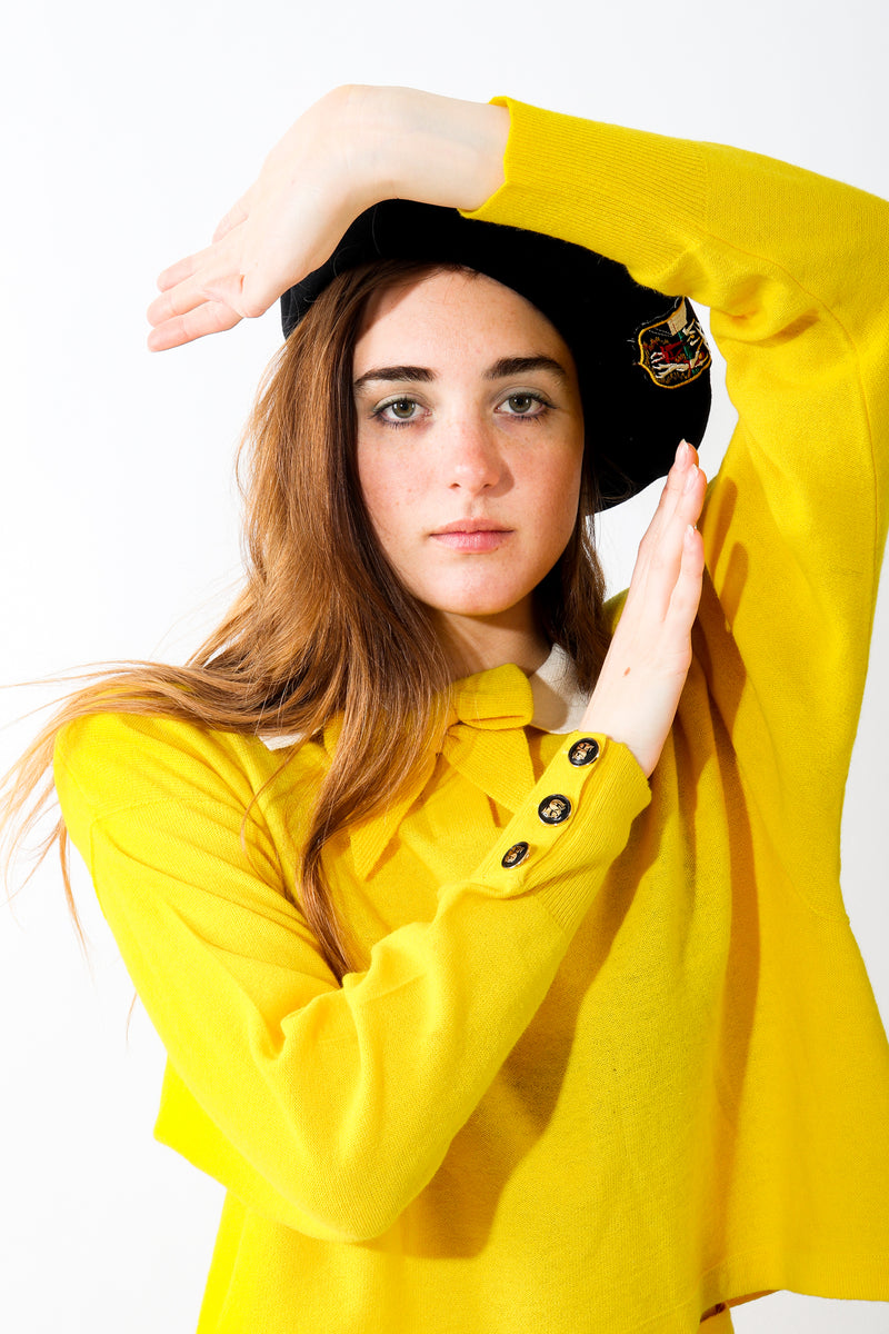 Girl in yellow wearing Vintage Sonia Rykiel Wool European Crest Beret