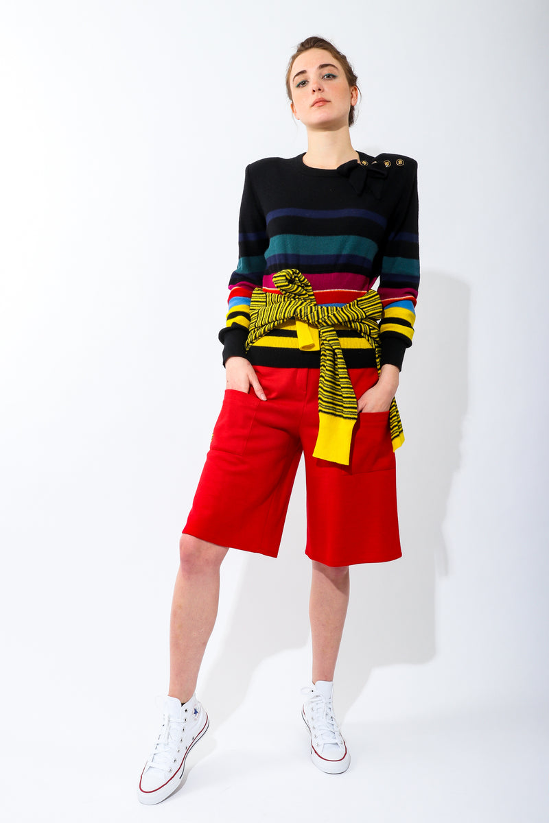 Girl Wearing Vintage Sonia Rykiel Rainbow Striped Knit Bow Sweater and red pant
