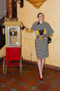Girl Wearing Vintage Sonia Rykiel Bouclé Houndstooth Pom Pom Shawl and Boucle Check Skirt suit