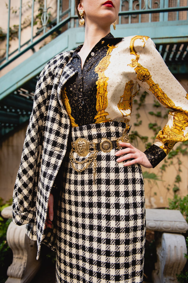 Girl wearing Vintage Gianni Versace Gold Medusa Head Drop Earrings with black and white check suit