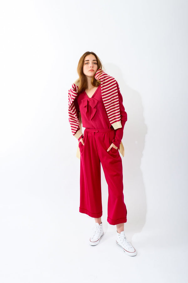 Girl wearing Vintage Sonia Rykiel Magenta Knit Bow Sweater & Cropped Trouser Set at Recess