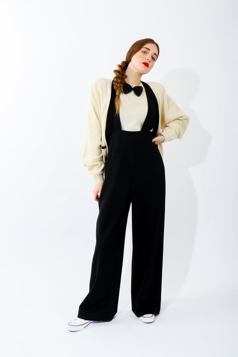 Girl in Vintage Sonia Rykiel Cream Knit Bow Tie Sweater with black suspender pants