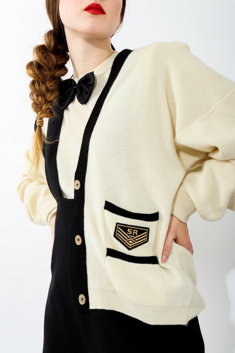 Girl wearing Vintage Sonia Rykiel Cream Knit Letterman Cardigan with bow tie sweater