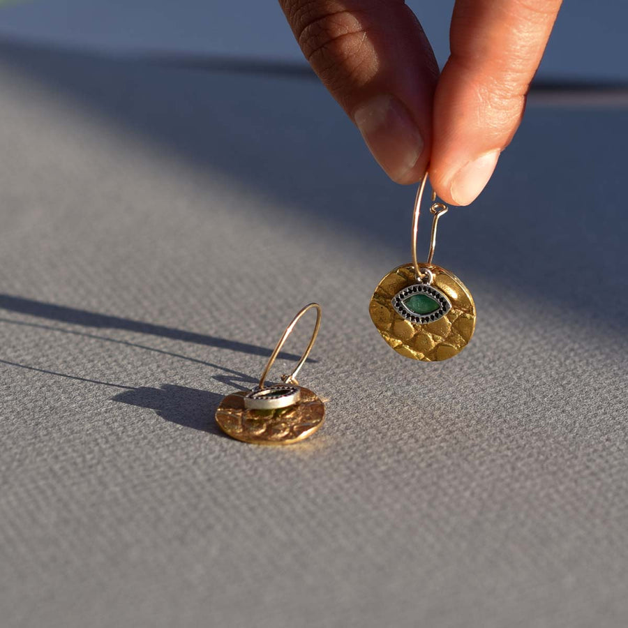 Gold disc crocodile texture earring with silver and emerald third eye. Handmade in Mexico City.