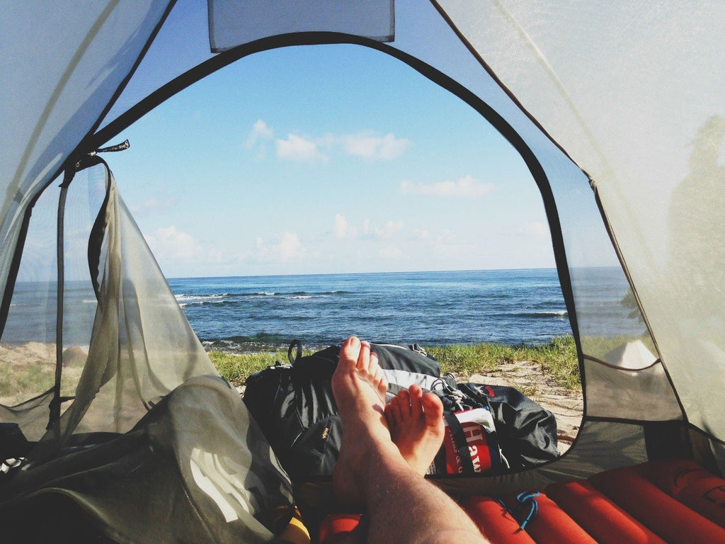 Camping Near the Waters: A Quick Guide on Picking Outdoor Gear at a Tent Sale