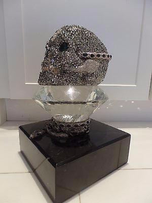 CRYSTAL AND EMERALD SKULL WITH MARBLE BASE