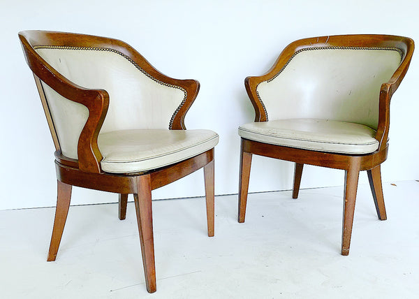 pair of wood frame chairs