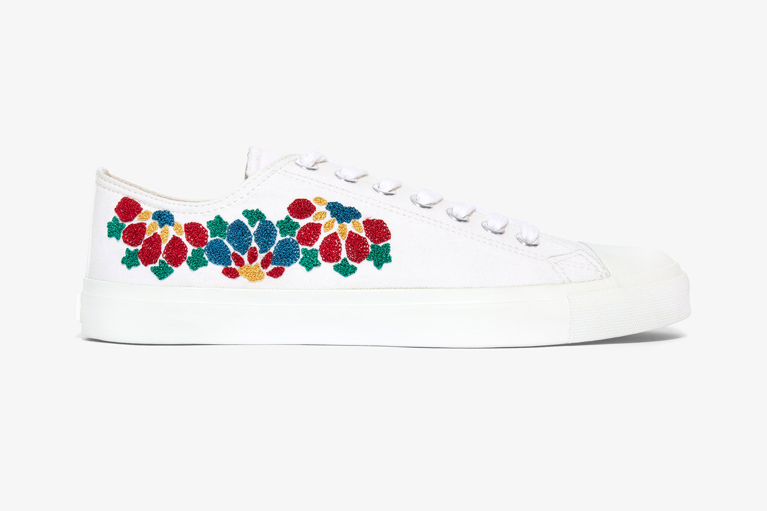 All white womens sneaker with hand embroidery