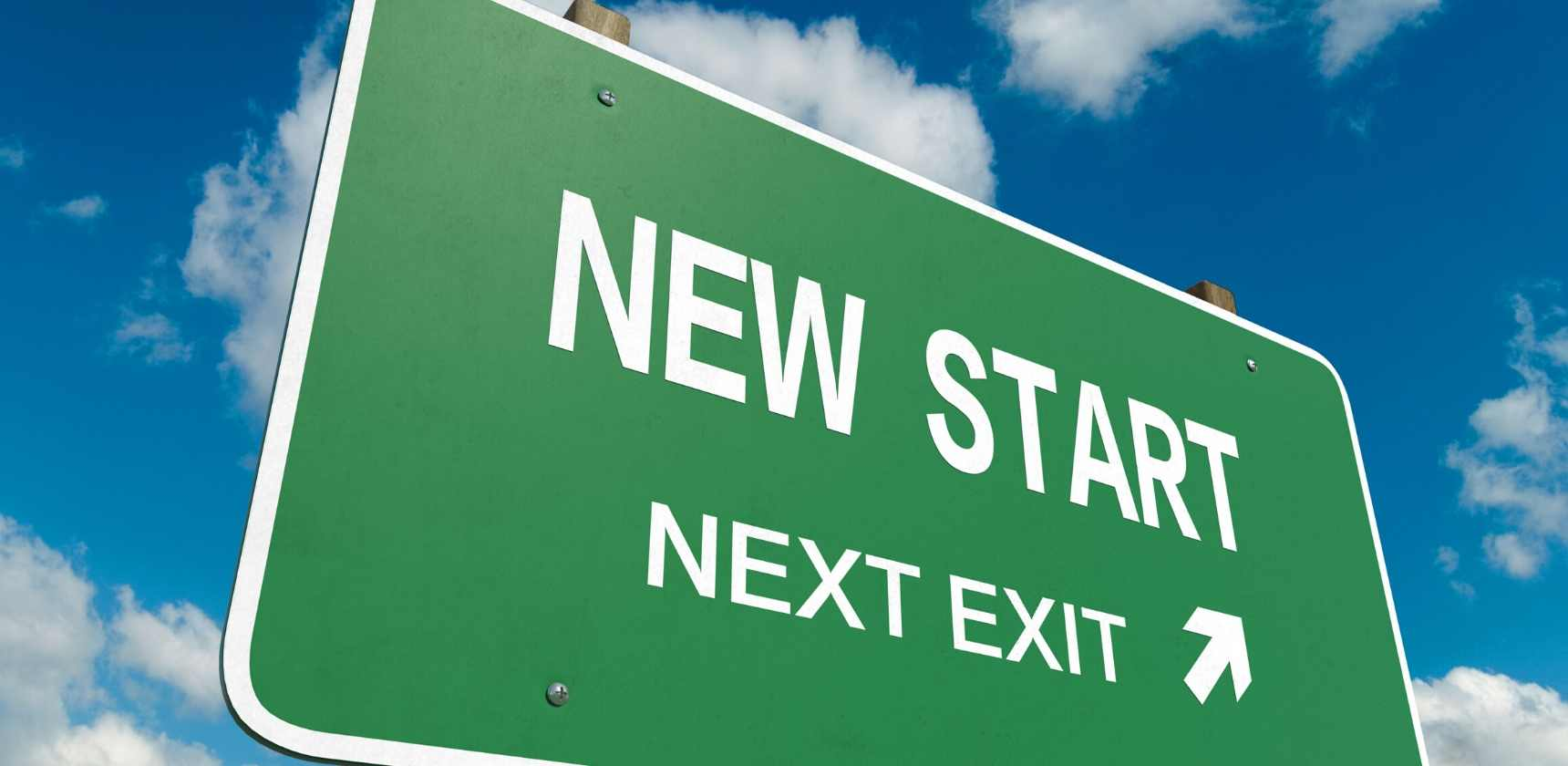 road sign showing new start