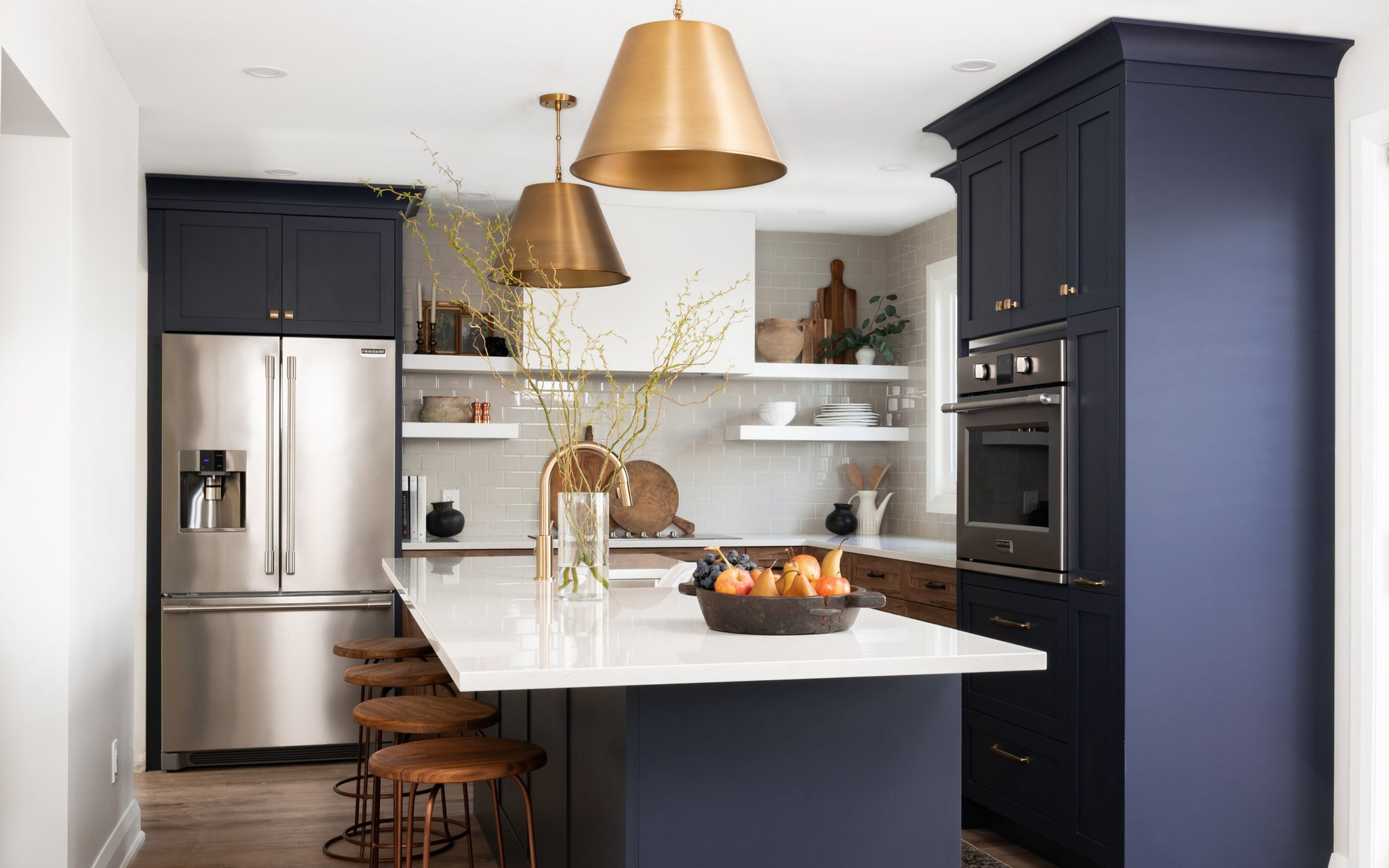 Two toned navy kitchen with gold accent interior design