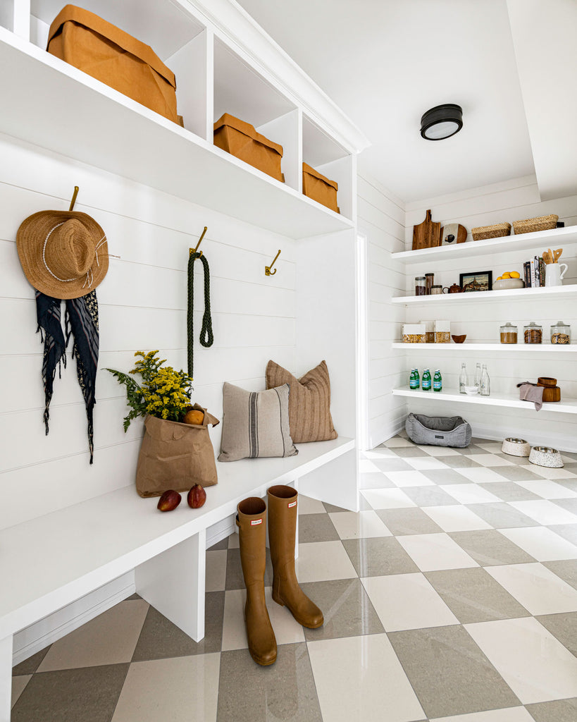 Mudroom with checkered floor tile and shiplap