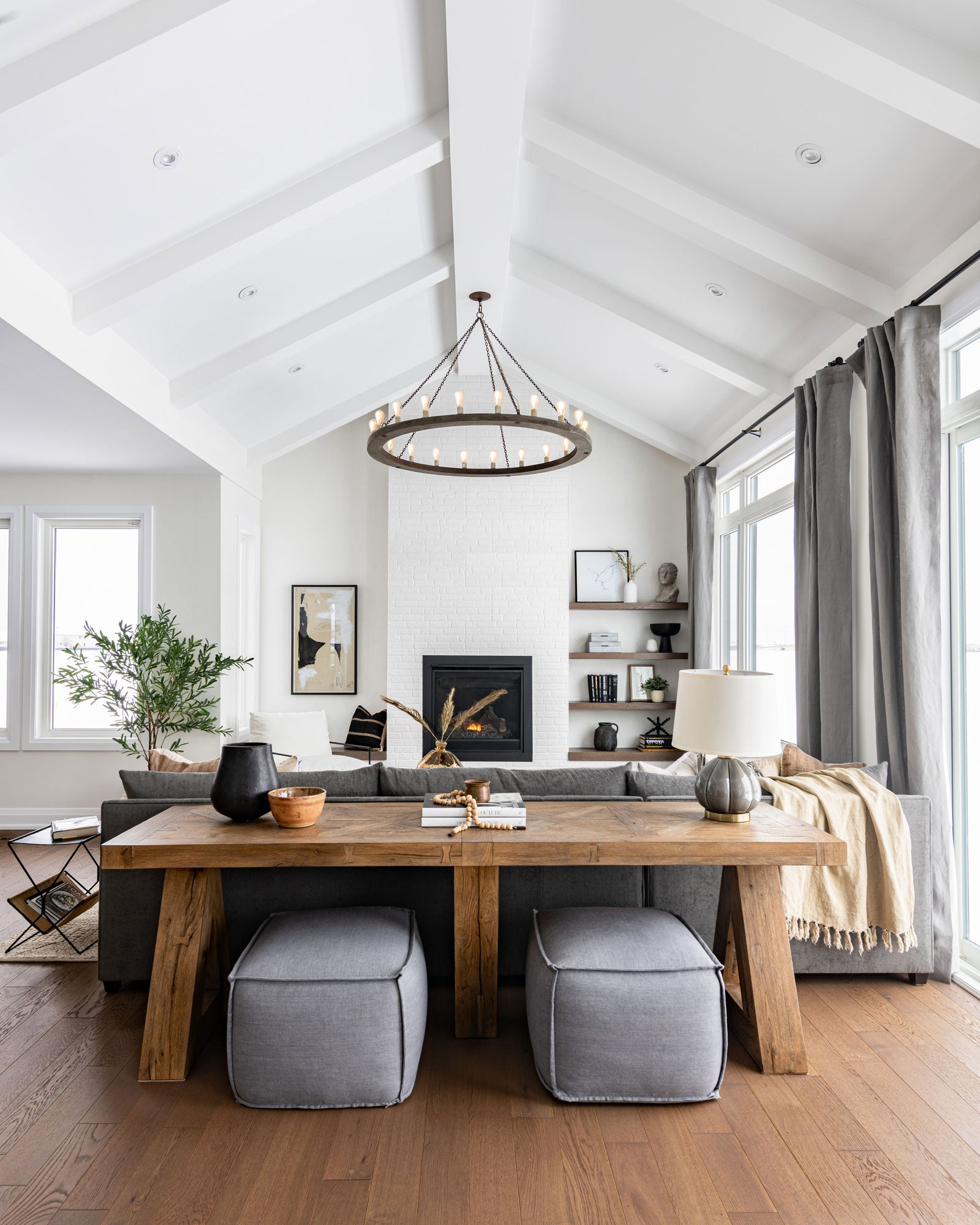 Living room with vaulted ceilings and fireplace