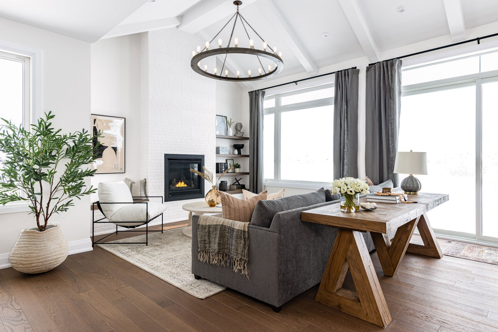 Furnished living Room with white brick fireplace