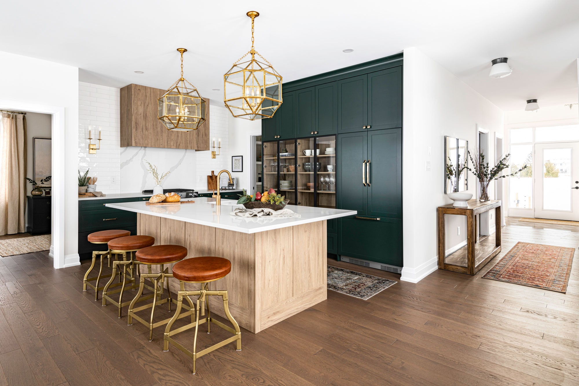 Two toned green and wood kitchen with gold accents