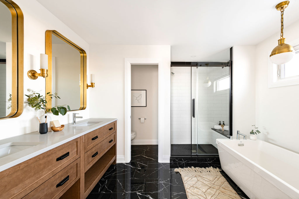bathroom with wooden vanity and black marble tile
