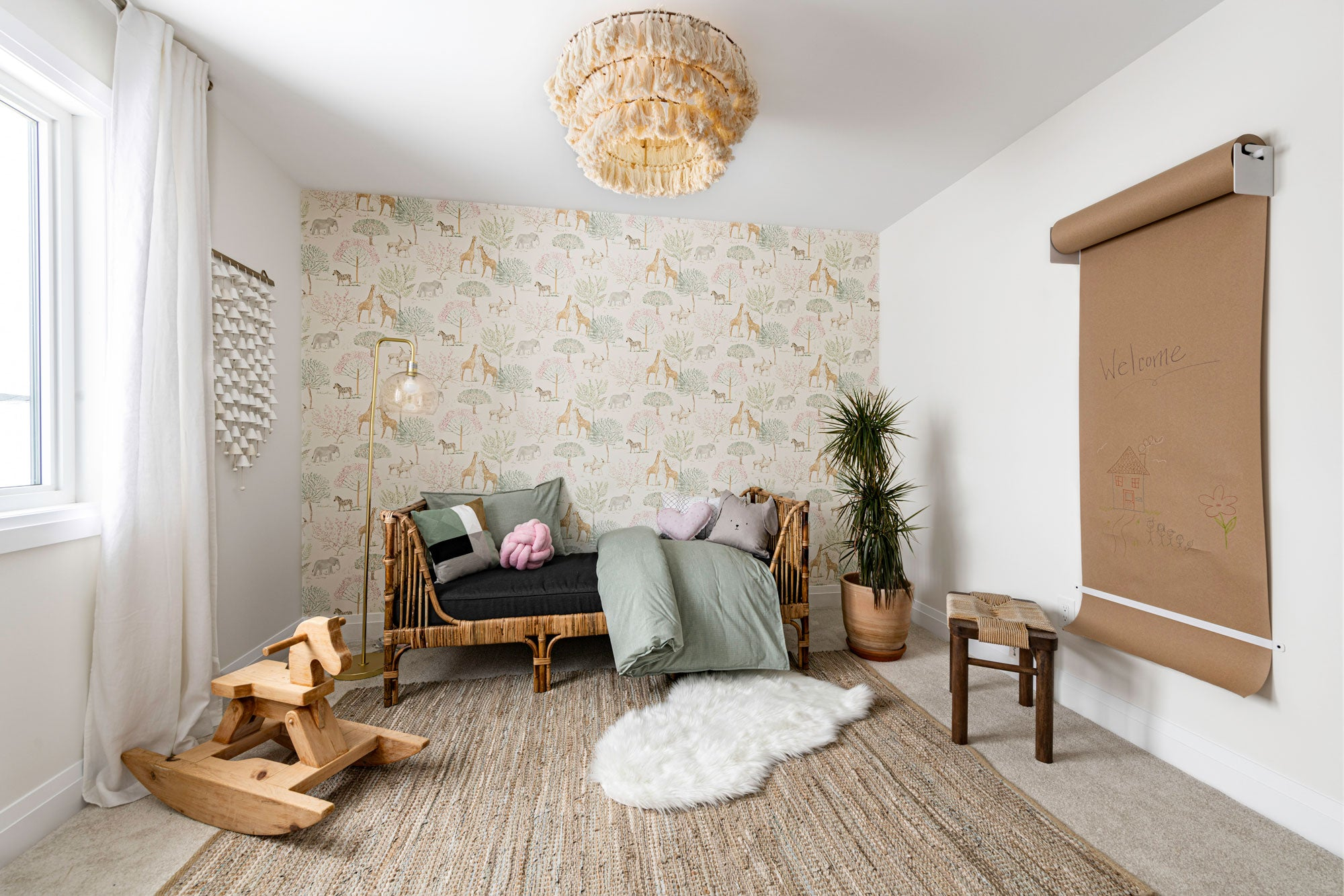 girls room with pastels, rattan bed and textured rug