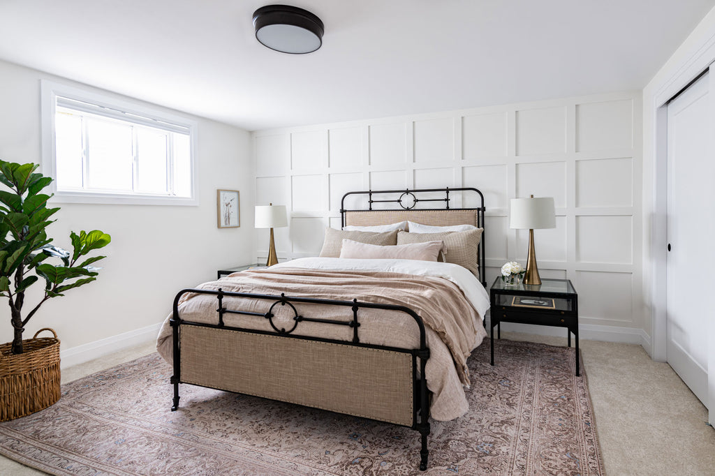 Guest bedroom with neutral colour palette and millwork