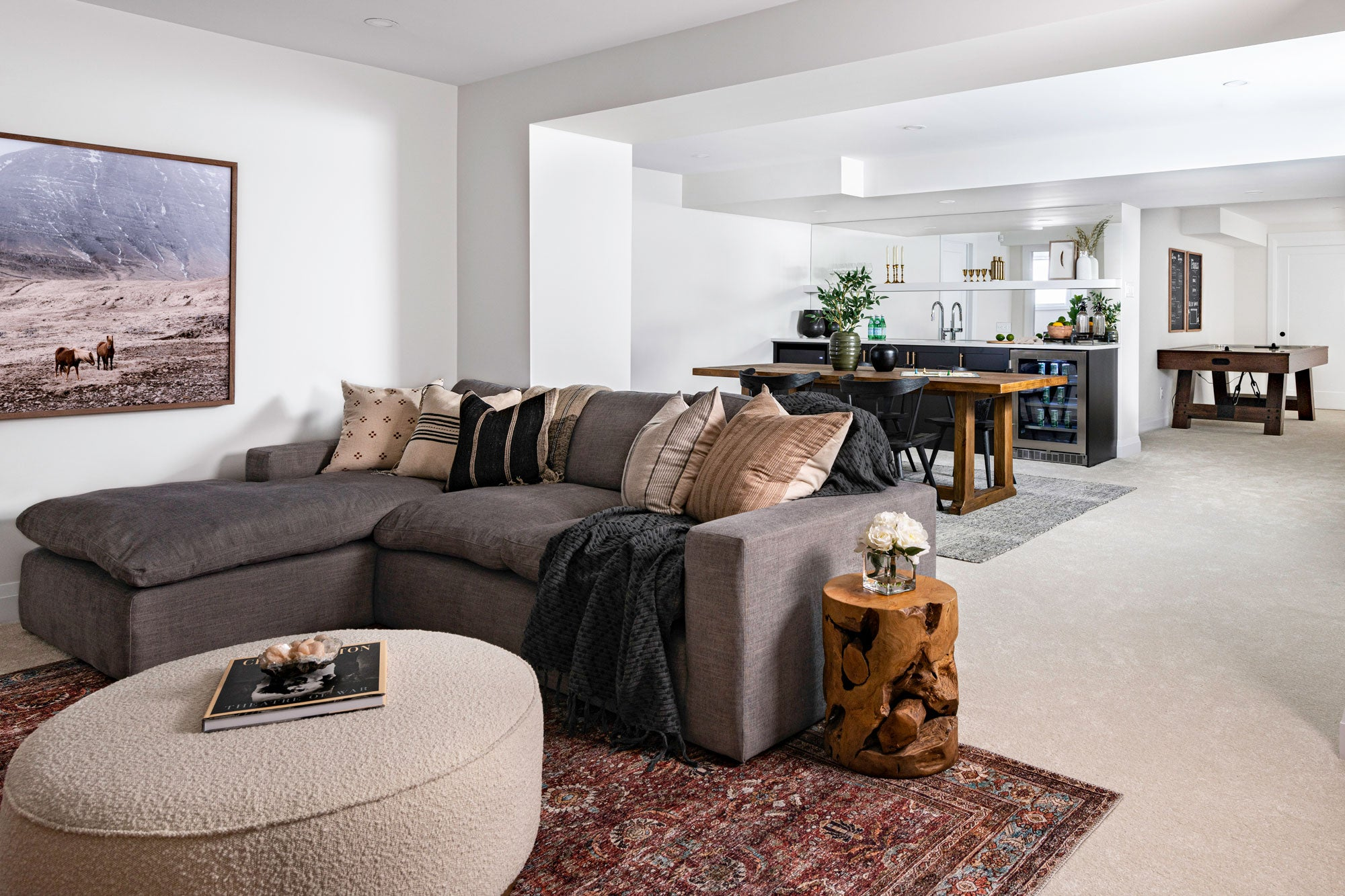 Basement tv area with grey sectional