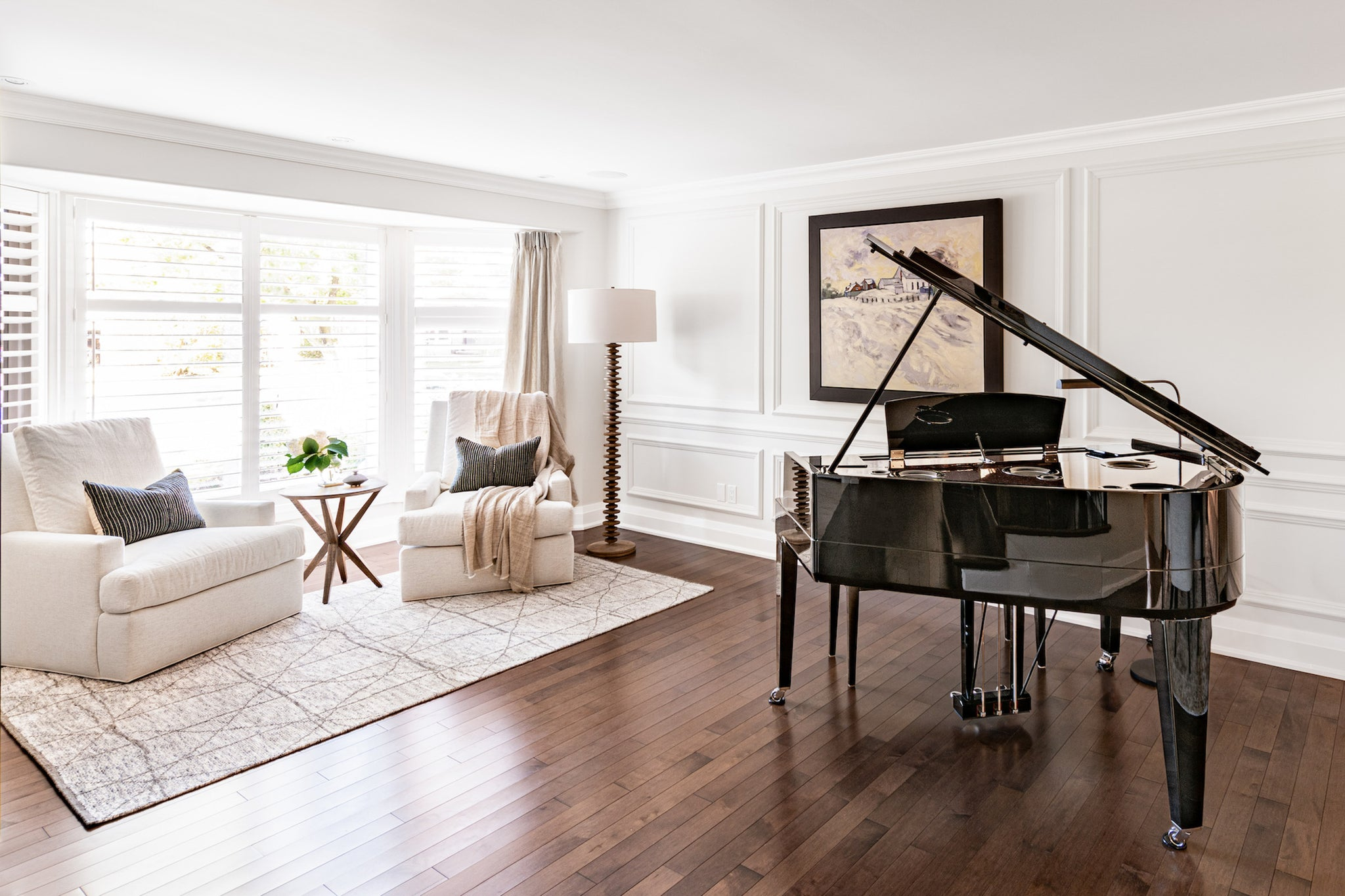 living room with grand piano.