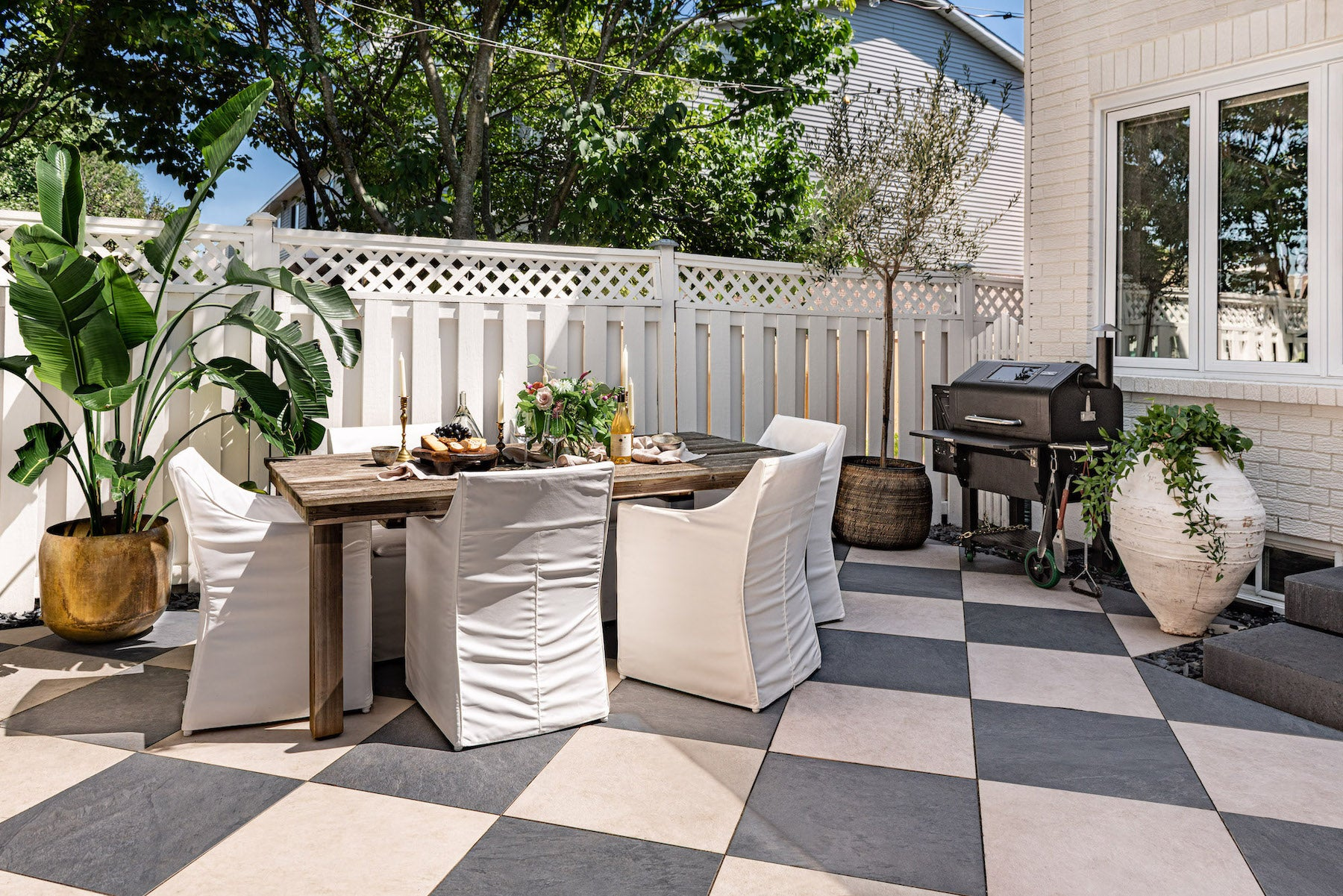 Backyard oasis, dining space and Green Mountain pellet grill.