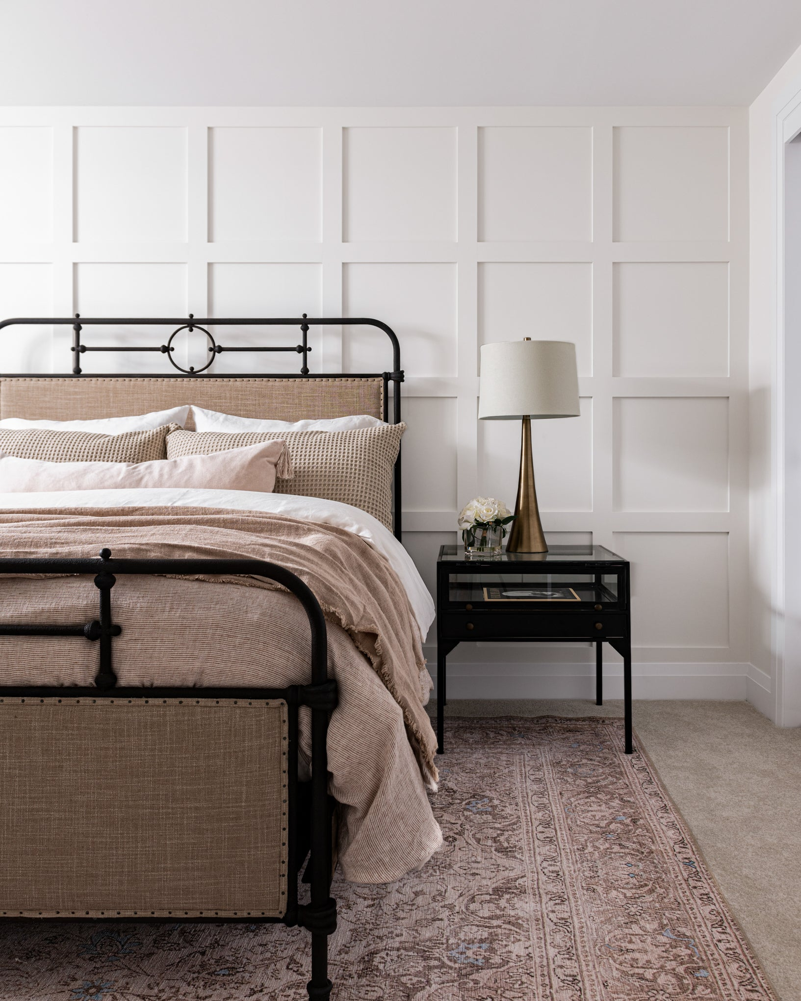 Nighstand and bed pairing in guest bedroom.