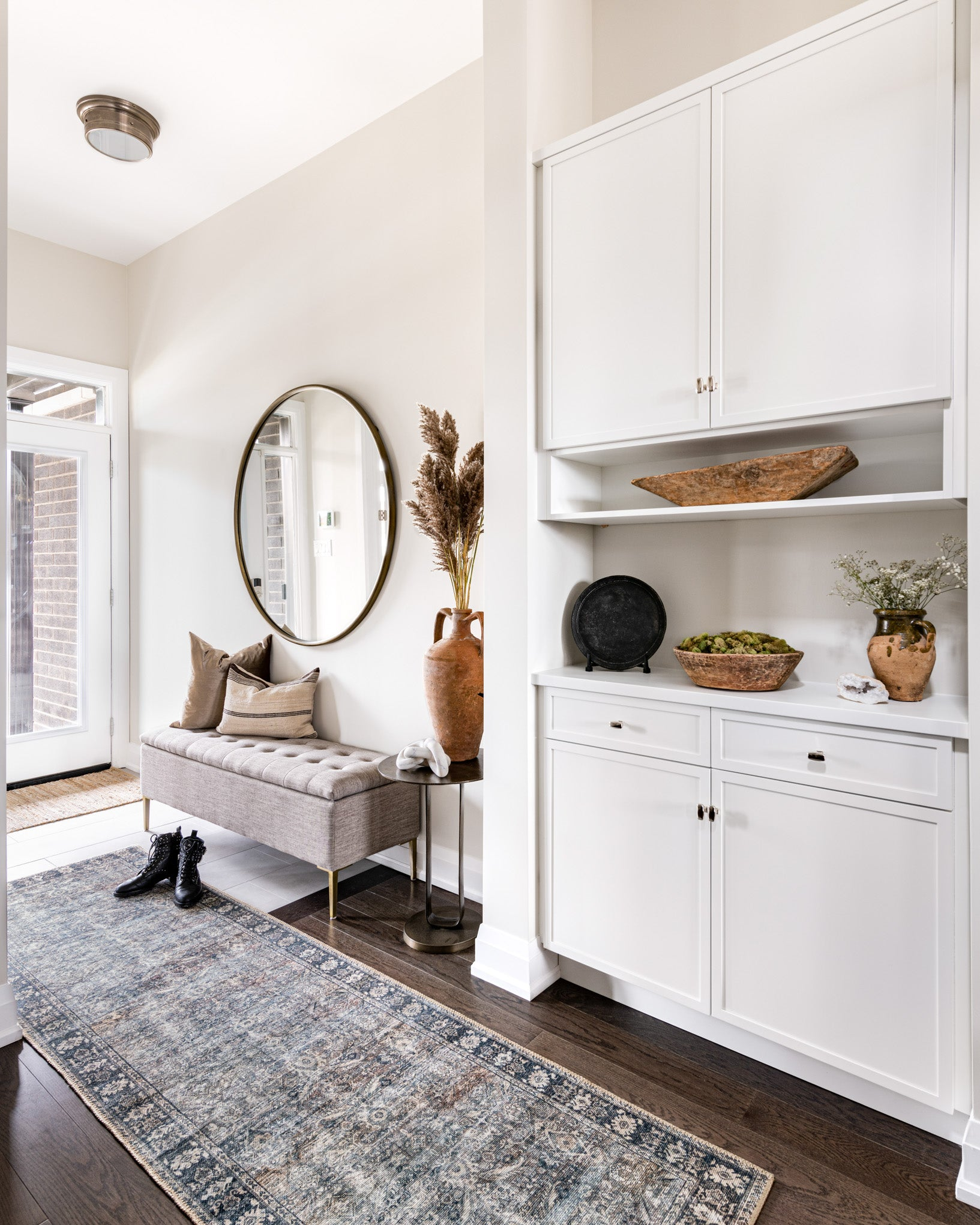 Entryway with runner and storage.