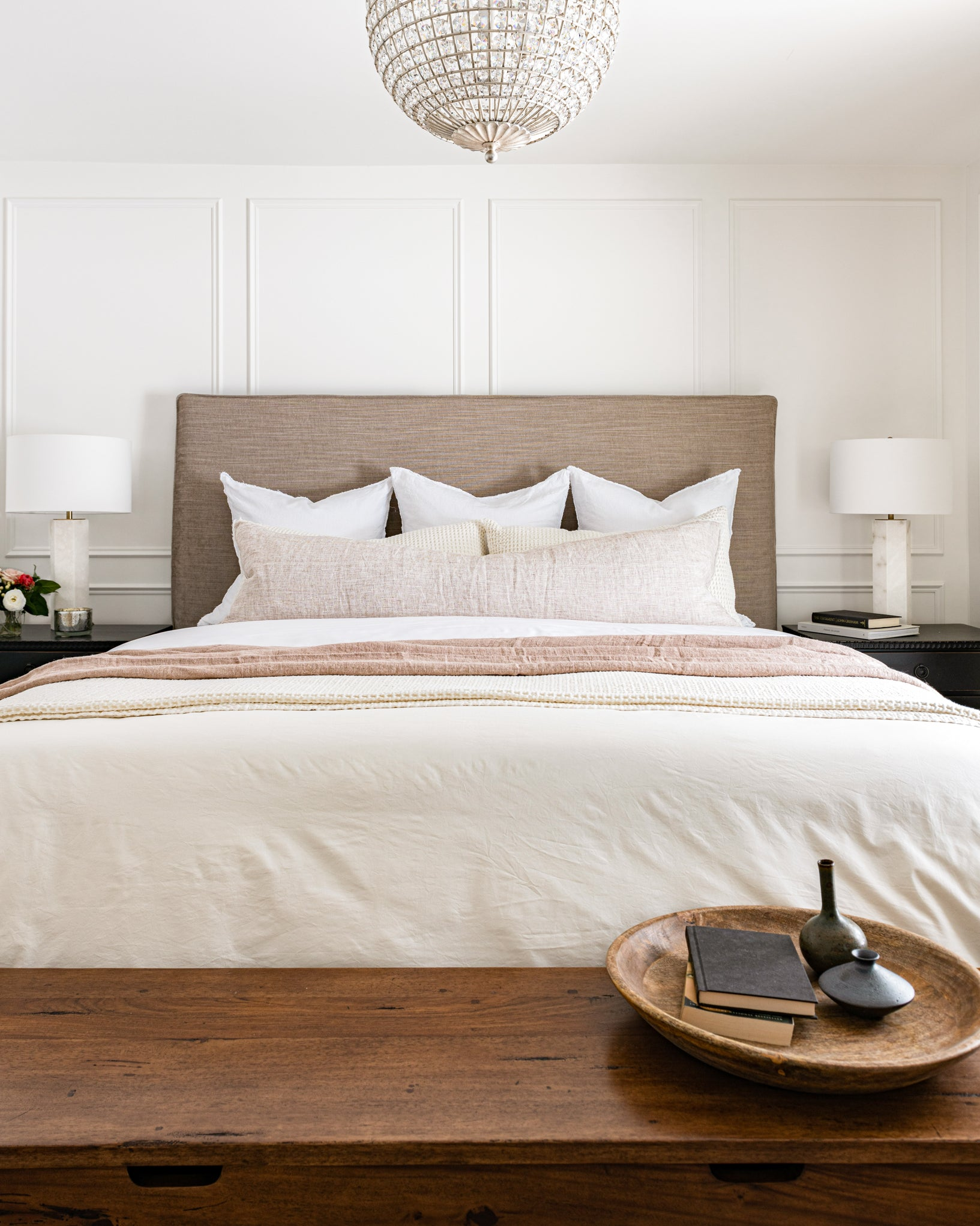 White and blush master bedroom.