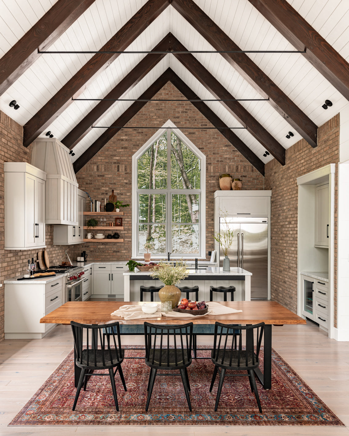 Kitchen with exposed brick wall.