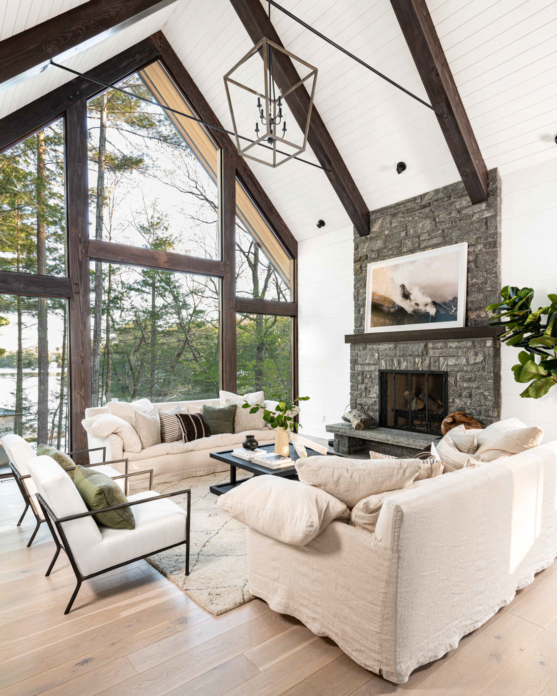 White living room with wood beam and white furniture.
