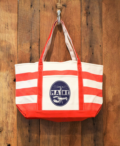red beach bag with lighthouse print