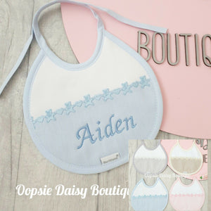 Personalised Spanish Round Bib With Teddy/Toys Towelling Back