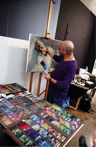 The soft pastels and pastel pencils in Vicente Romero's studio as the master works on The Dreamer.
