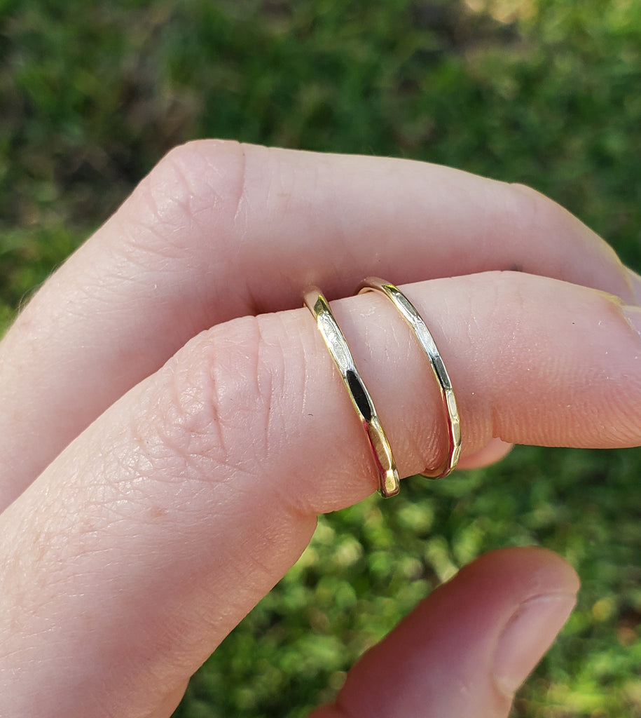 two thin gold rings, minimalist style