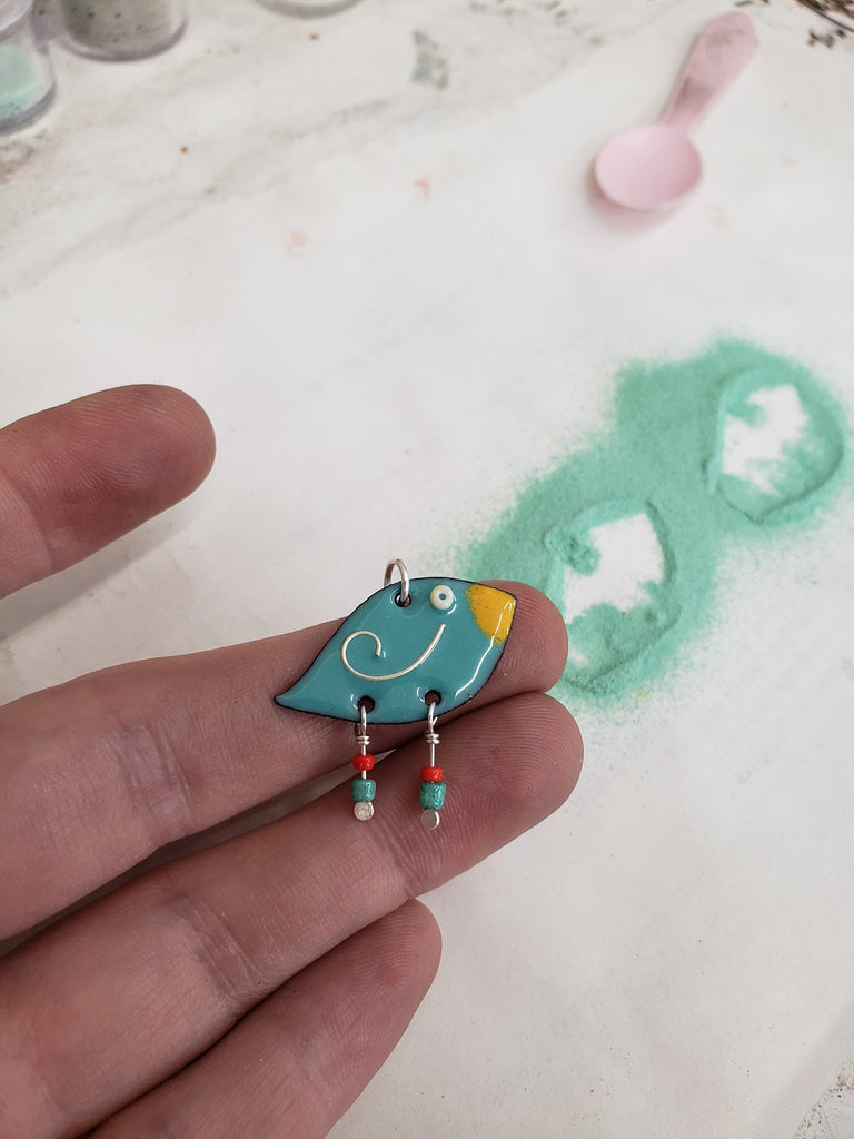 whimsical bird pendant by enameling powdered glass