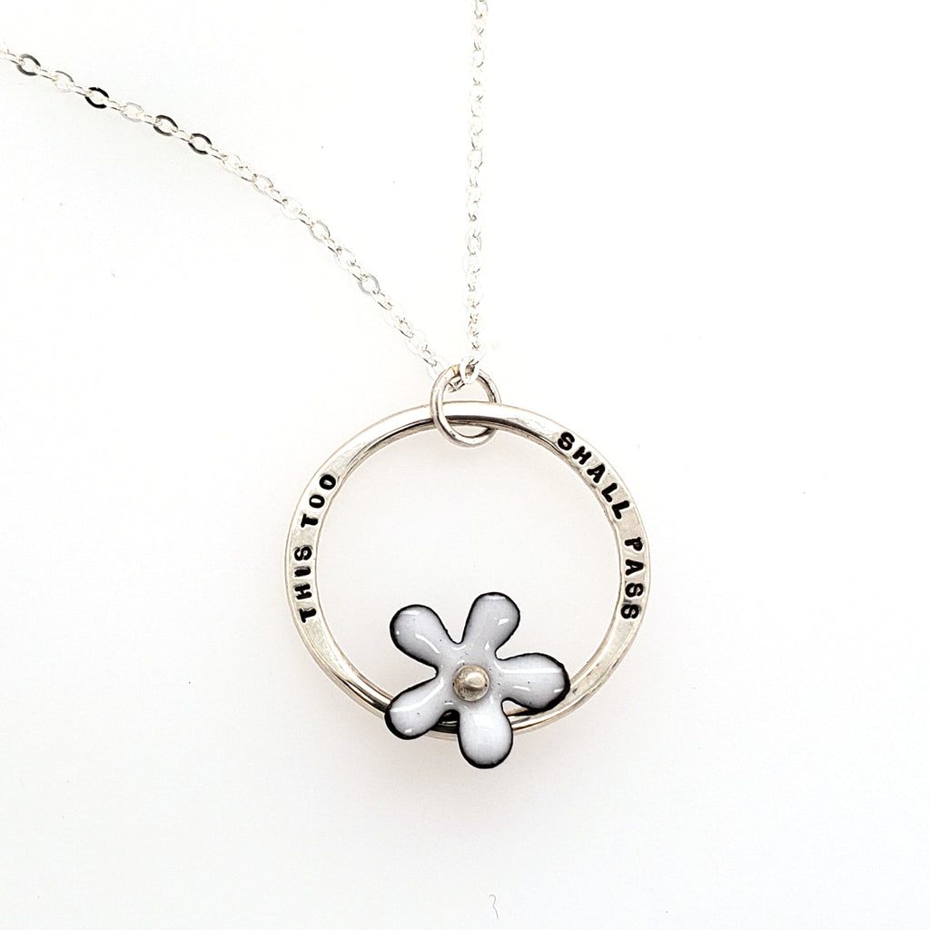 hand stamped pendant with flower