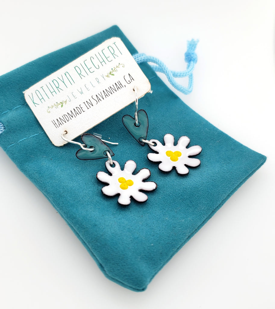 white flower with blue heart earrings